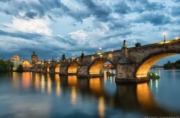 Shortly after sunset, beautiful dramatic clouds begin to roll over Charles Bridge in Prague.
